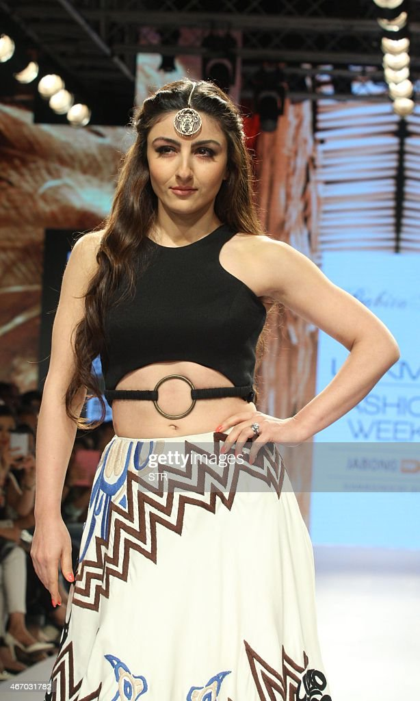 Indian Bollywood actress Soha Ali Khan showcases a creation by designer Babita M on the third day of the Lakme Fashion Week summer/resort 2015 in...