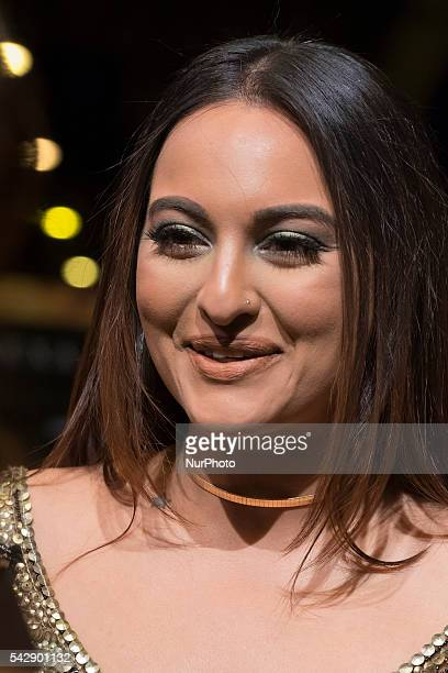 Indian Bollywood actress Sonakshi Sinha poses on the green carpet as she arrives to the 17th edition of IIFA Awards in Madrid on June 24 2016
