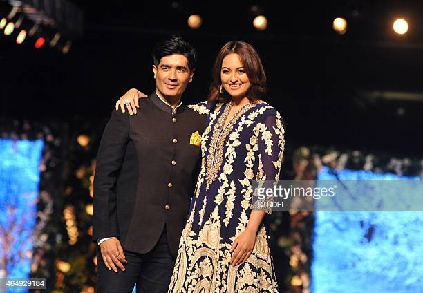 Indian Bollywood actress Sonakshi Sinha poses with designer Manish Malhotra during the tenth annual Caring with Style fashion show in association...