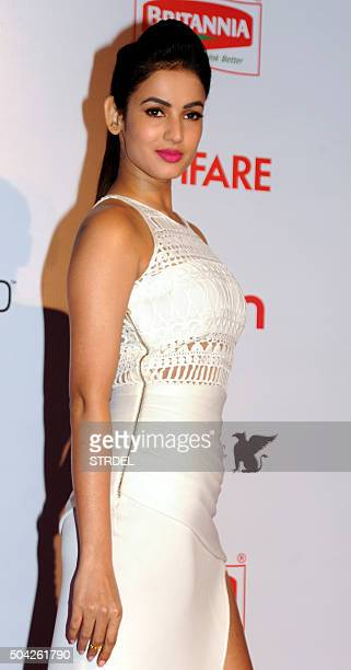 Indian Bollywood actress Sonal Chauhan poses for a photograph during the Filmfare Awards 2016 party in Mumbai on late January 9 2016 AFP PHOTO / STR...