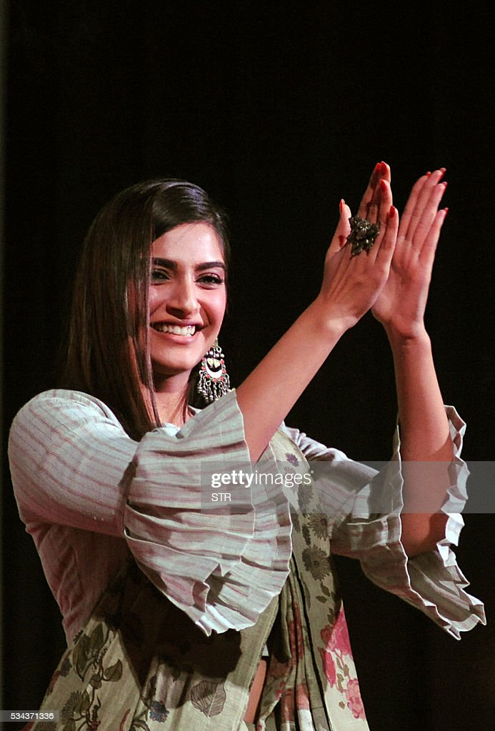 Indian Bollywood actress Sonam Kapoor applauds onstage during the 'Kashish Mumbai International Queer Film Festival 2016', South Asia's biggest LGBT film festival in Mumbai on late May 25, 2016. / AFP / STR