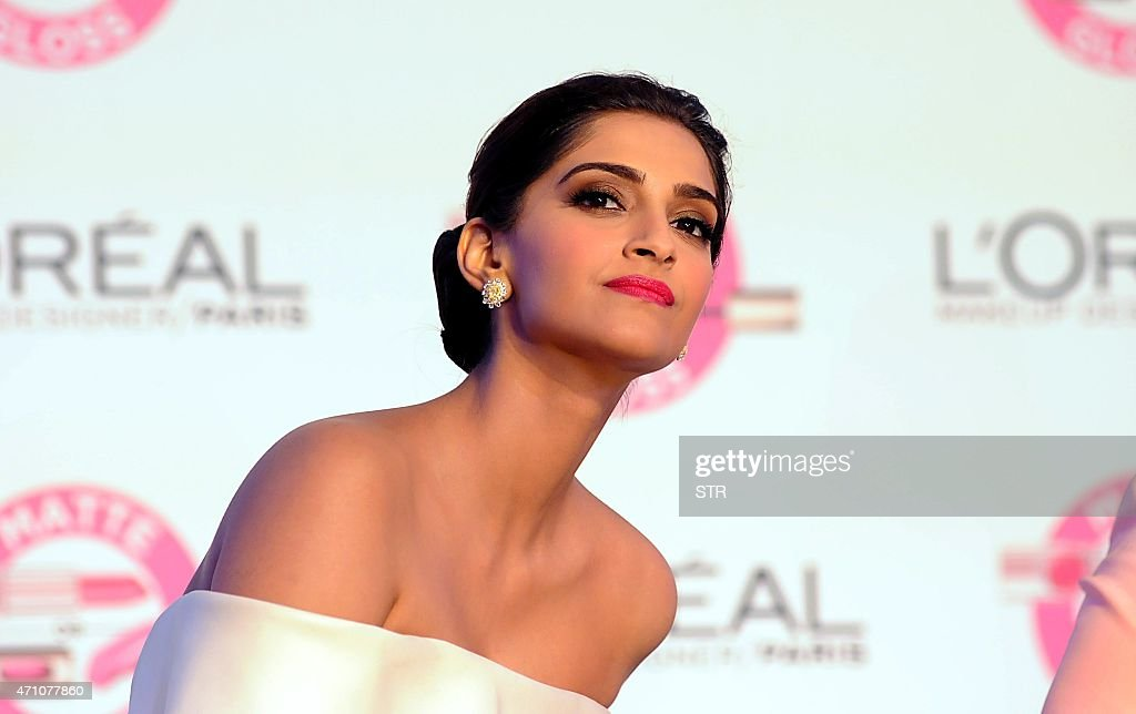 Indian Bollywood actress Sonam Kapoor displays a L'Oreal Paris creation for its new Cannes collection in Mumbai on April 25 2015 AFP PHOTO