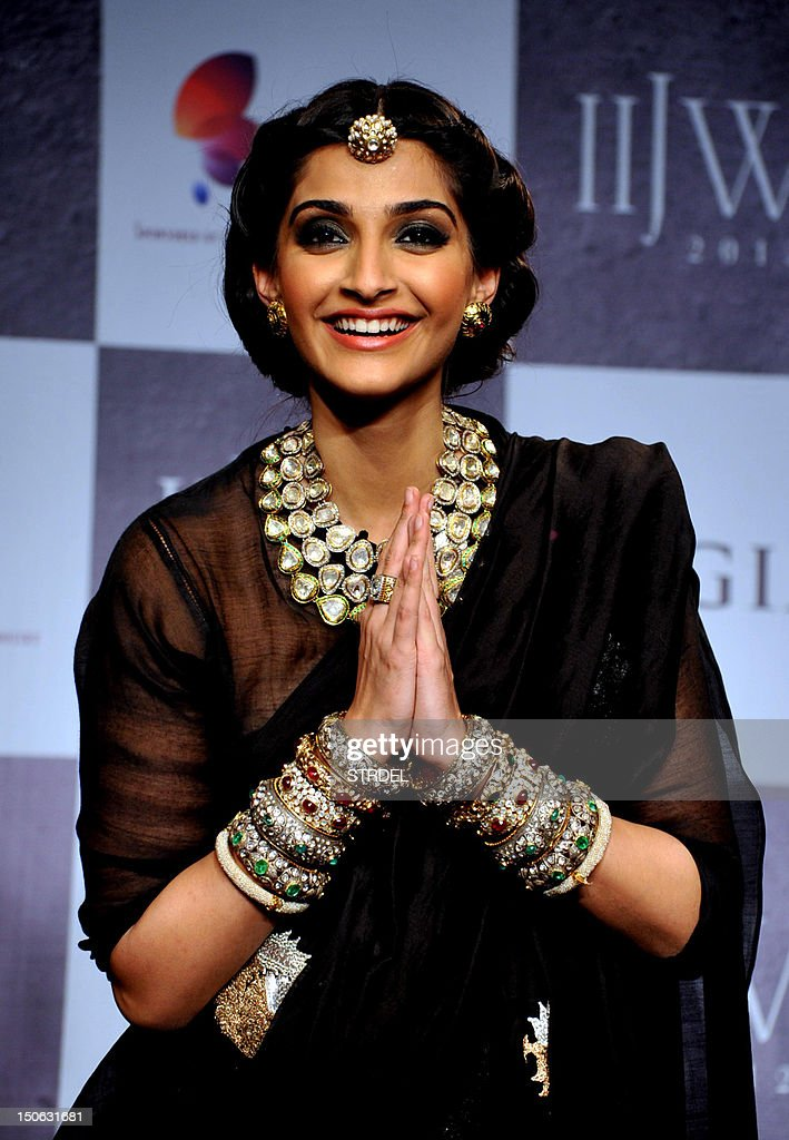 Indian Bollywood actress Sonam Kapoor gestures during the grand finale of India International Jewellery Week 2012 (IIJW) in Mumbai on August 23, 2012.