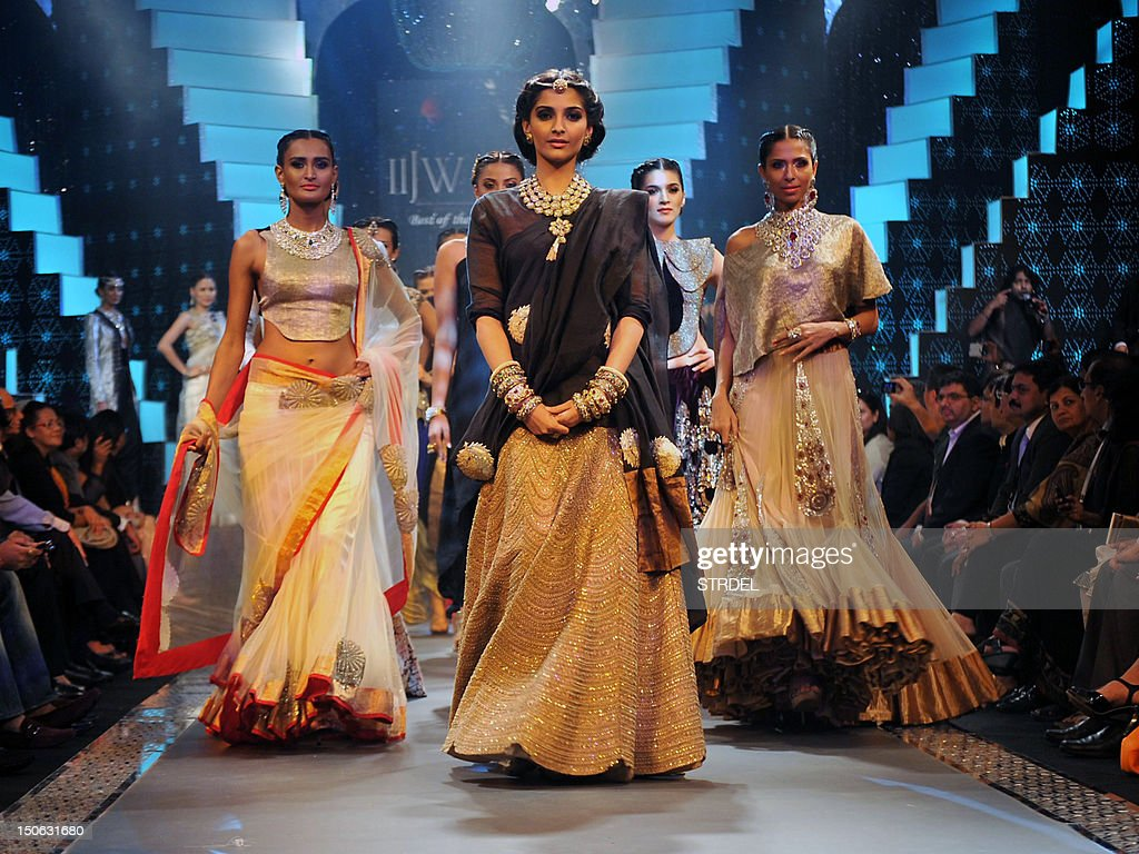 Indian Bollywood actress Sonam Kapoor (C) walks the ramp during the grand finale of India International Jewellery Week 2012 (IIJW) in Mumbai on August 23, 2012.