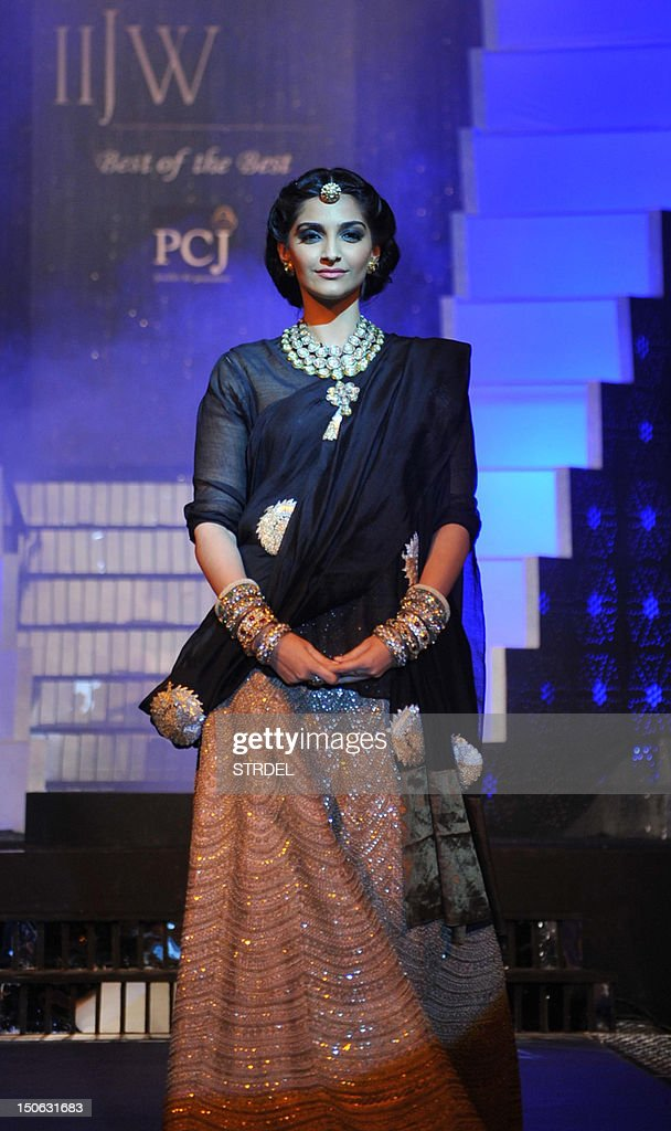 Indian Bollywood actress Sonam Kapoor walks the ramp during the grand finale of India International Jewellery Week 2012 (IIJW) in Mumbai on August 23, 2012.