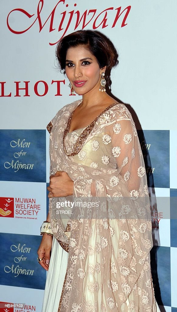 Indian Bollywood actress Sophie Choudry poses for a photograph during a charity fashion show in Mumbai on late April 1, 2014.