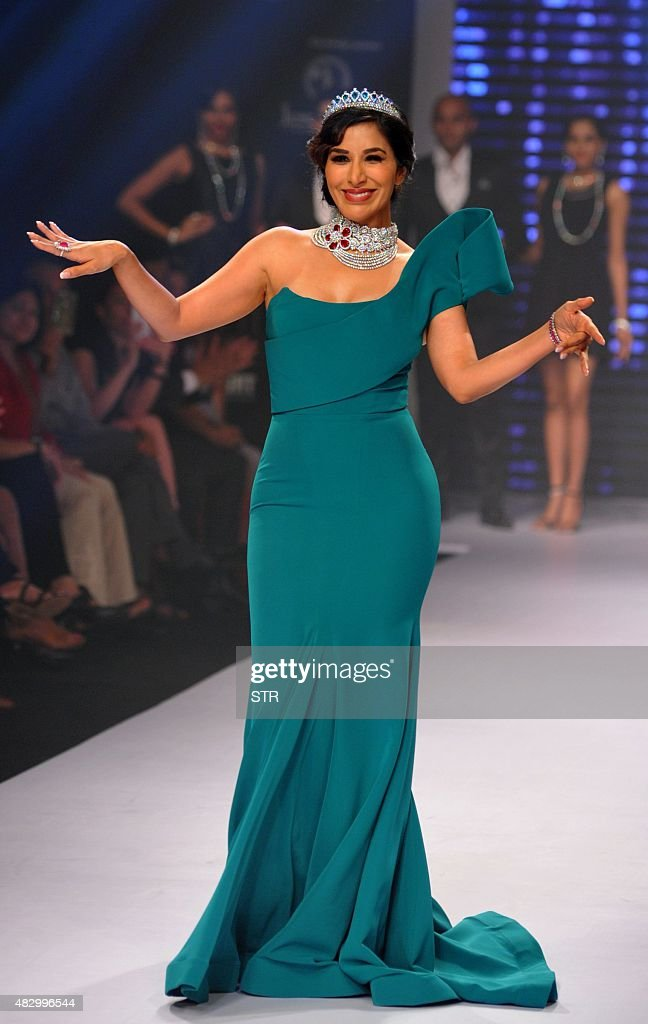 Indian Bollywood actress <a gi-track='captionPersonalityLinkClicked' href=/galleries/search?phrase=Sophie+Choudry&family=editorial&specificpeople=6598413 ng-click='$event.stopPropagation()'>Sophie Choudry</a> showcases a creation during India International Jewellery Week 2015 in Mumbai on August 5, 2015.