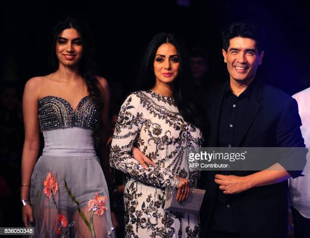 Indian Bollywood actress Sridevi Kapoor with daughter Jhanvi and designer Manish Malhotra pose for a photograph during the grand finale of Lakme...