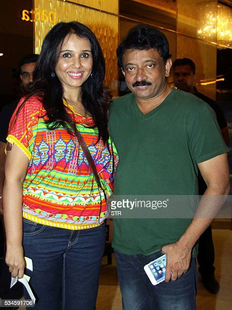 Indian Bollywood actress Suchitra Krishnamoorthi and director Ram Gopal Varma pose for a photograph during a promotional event for the forthcoming...