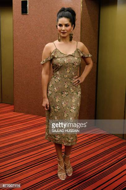 Indian Bollywood actress Sunny Leone poses for photographers during a promotional event for her upcoming movie 'Tera Intezaar' in New Delhi on...