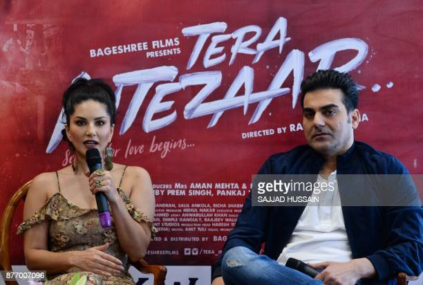 Indian Bollywood actress Sunny Leone speaks next to actor Arbaaz Khan during a promotional event for their upcoming movie 'Tera Intezaar' in New...