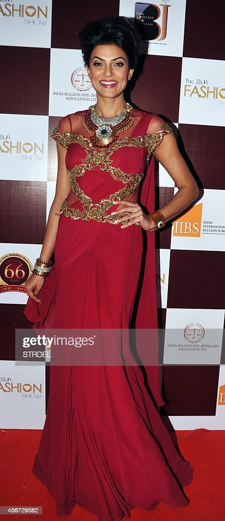 Indian Bollywood actress Sushmita Sen showcases a creation by designer Sonakshi Raaz during the Indian Bullion Jewellery Association Fashion Show in...