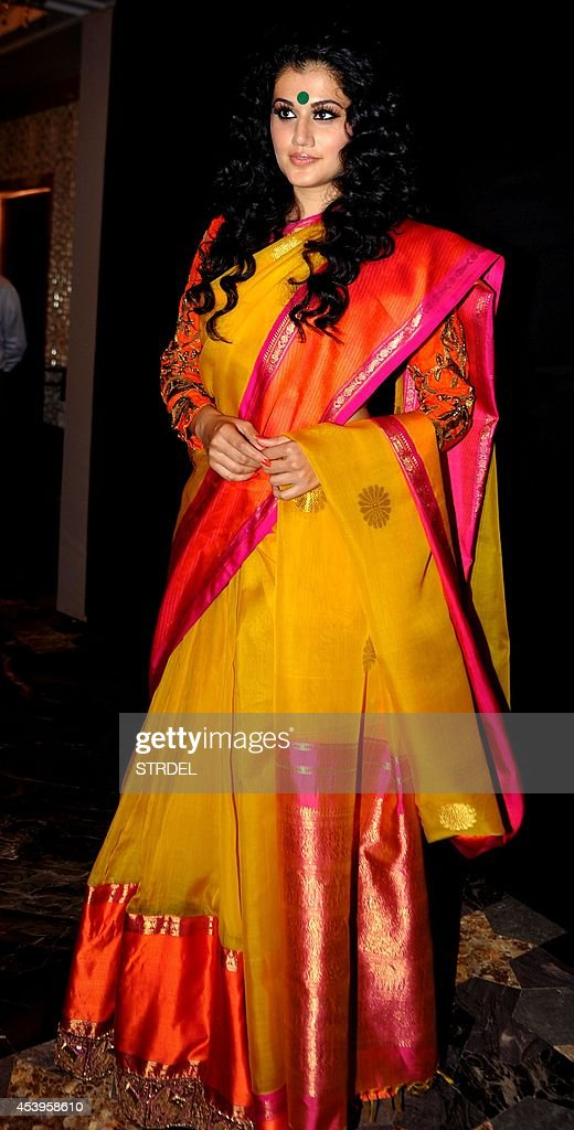 Indian Bollywood actress Taapsee Pannu poses during the Lakme Fashion Week (LFW) Winter/Festival 2014 in Mumbai on August 22, 2014.