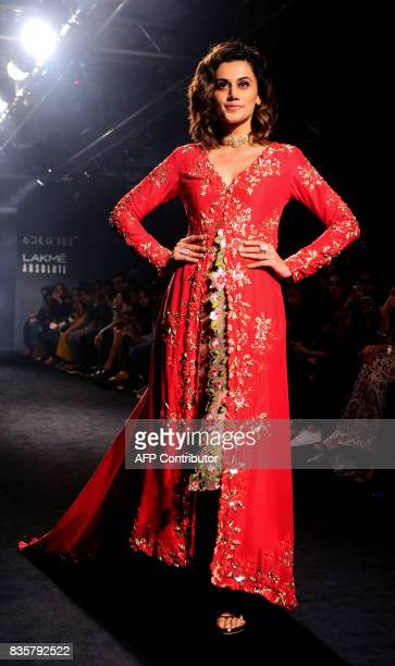 Indian Bollywood actress Taapsee Pannu showcases a creation by designer Divya Reddy at the Lakme Fashion Week Winter/Festive 2017 in Mumbai on August...