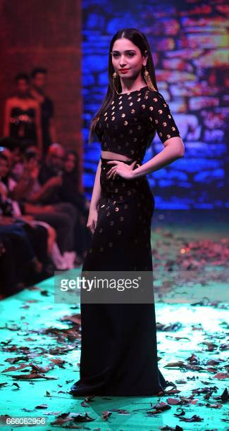Indian Bollywood actress Tammanah Bhatia showcases a collection inspired by the upcoming Hindi film 'Baahubali 2' in Mumbai on April 7 2017 / AFP...