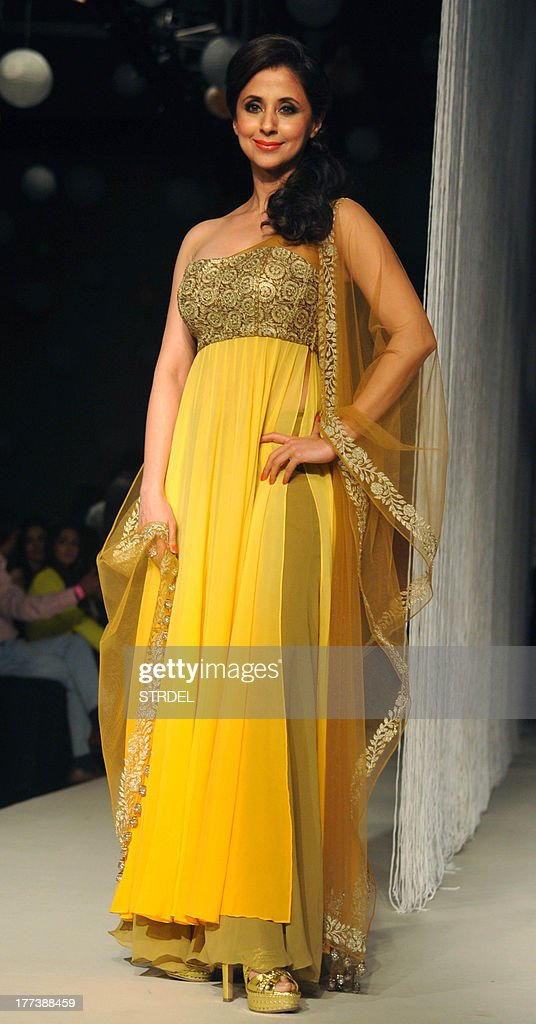 Indian Bollywood actress Urmila Matondkar attends the Lakme Fashion Week (LFW) Winter/Festival 2013 in Mumbai on August 22, 2013.