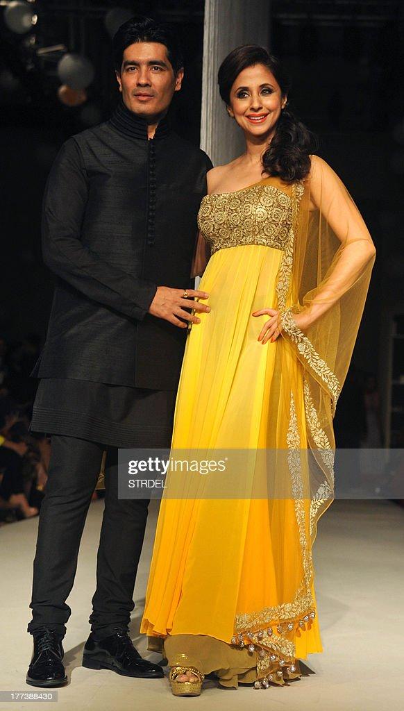 Indian Bollywood actress Urmila Matondkar poses with designer Manish Malhotra during the Lakme Fashion Week (LFW) Winter/Festival 2013 in Mumbai on August 22, 2013. AFP PHOTO/STR