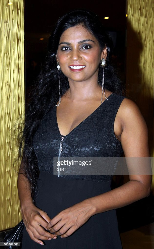 Indian Bollywood actress Usha Jadhav poses for a photograph during a promotional event for the forthcoming Hindi film 'Veerappan' in Mumbai on late May 26, 2016. / AFP / STR