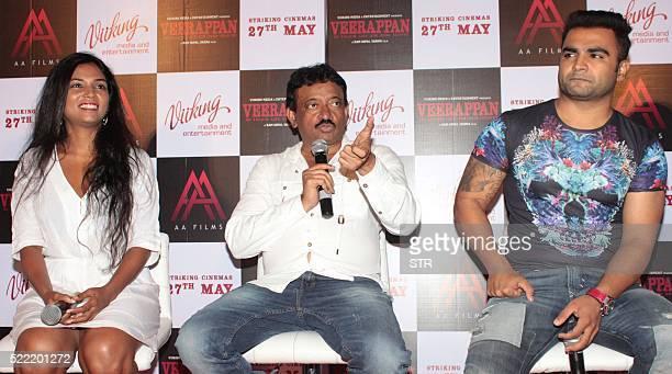Indian Bollywood actress Usha Jadhavposes alongside actor and producer Sachiin J Joshias director Ram Gopal Varma addresses media during the trailer...