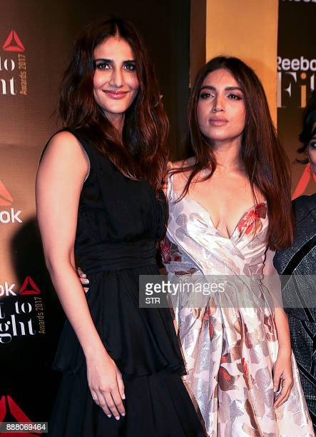 Indian Bollywood actress Vaani Kapoor and Bhumi Pednekar attend the 'Fit To Fight Awards' ceremony in Mumbai on December 7 2017 / AFP PHOTO / STR
