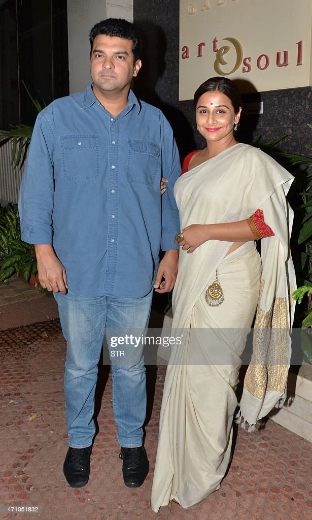Indian Bollywood actress Vidya Balan and her husband Siddhartha Roy Kapur attend the 'Under Construction' Sculptor Show in Mumbai on April 24, 2015.