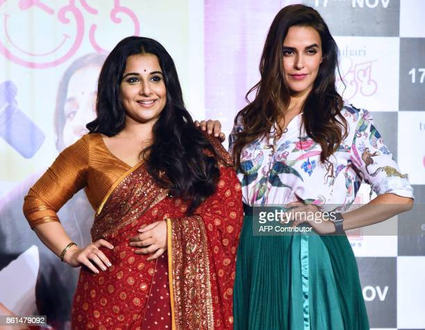 Indian Bollywood actress Vidya Balan and Neha Dhupia pose for a picture during the trailer launch of the upcoming comedydrama Hindi film 'Tumhari...
