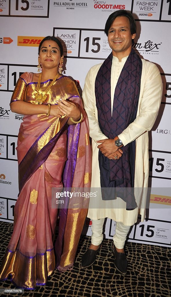 Indian Bollywood actress <a gi-track='captionPersonalityLinkClicked' href=/galleries/search?phrase=Vidya+Balan&family=editorial&specificpeople=563348 ng-click='$event.stopPropagation()'>Vidya Balan</a> (L) and <a gi-track='captionPersonalityLinkClicked' href=/galleries/search?phrase=Vivek+Oberoi&family=editorial&specificpeople=627274 ng-click='$event.stopPropagation()'>Vivek Oberoi</a> attend the second day of the Lakme Fashion Week (LFW) summer/resort 2015 in Mumbai on March 19, 2015.