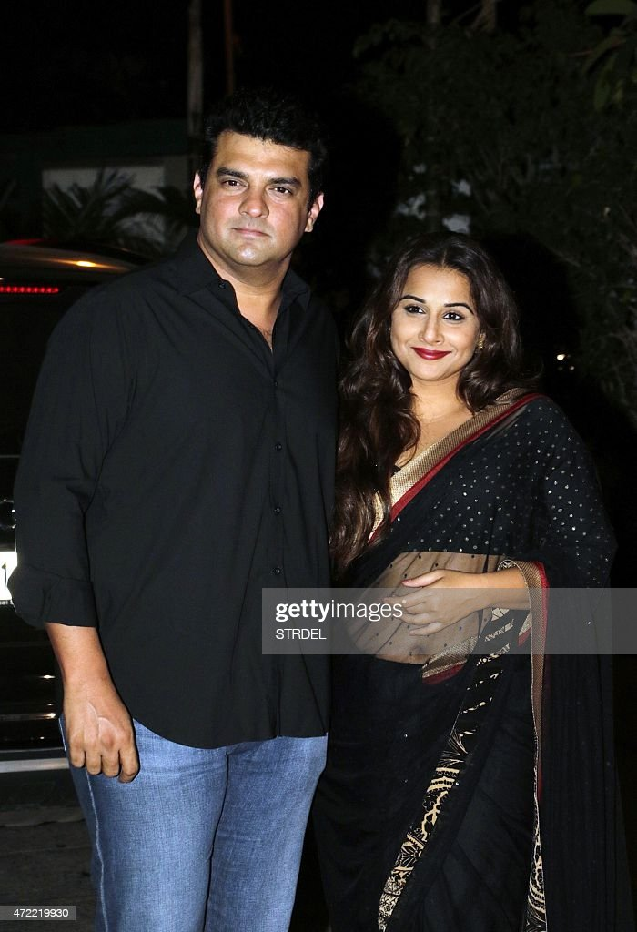 Indian Bollywood actress Vidya Balan (R) poses with her husband <a gi-track='captionPersonalityLinkClicked' href=/galleries/search?phrase=Siddharth+Roy+Kapur&family=editorial&specificpeople=6236847 ng-click='$event.stopPropagation()'>Siddharth Roy Kapur</a> as they attend a function in Mumbai late May 4, 2015, to celebrate actress Kangana Ranaut winning the National Award for best actress.
