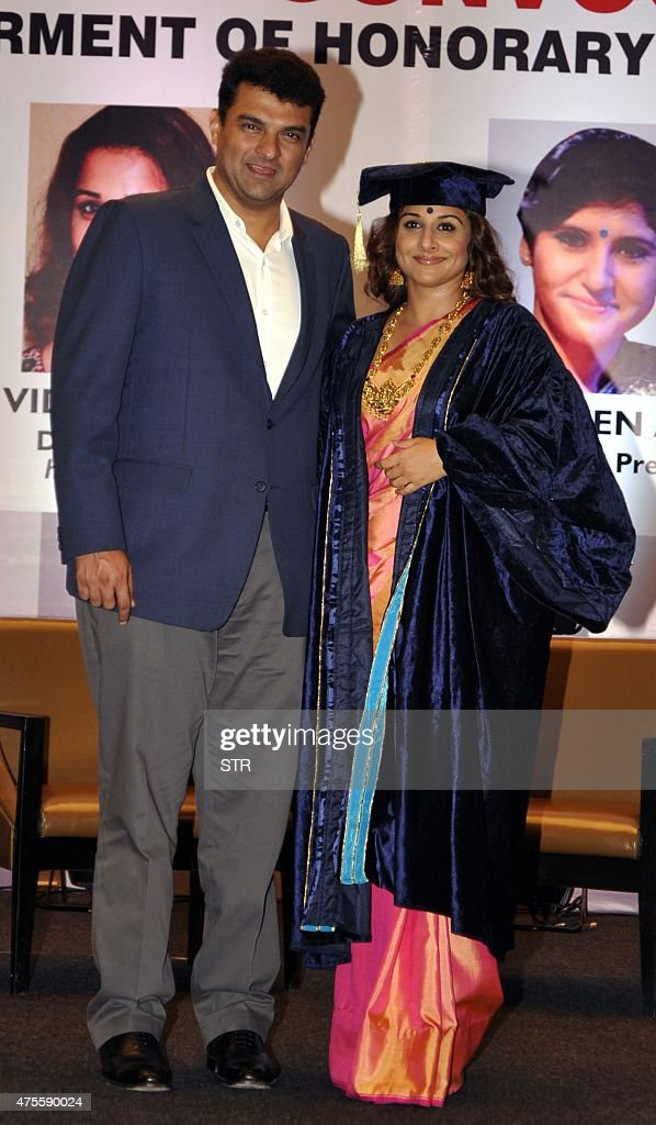 Indian Bollywood actress Vidya Balan (R) stands with her producer husband <a gi-track='captionPersonalityLinkClicked' href=/galleries/search?phrase=Siddharth+Roy+Kapur&family=editorial&specificpeople=6236847 ng-click='$event.stopPropagation()'>Siddharth Roy Kapur</a> as she is given an honorary doctorate for her contribution to Indian cinema at Rai University in Mumbai late on June 1, 2015.