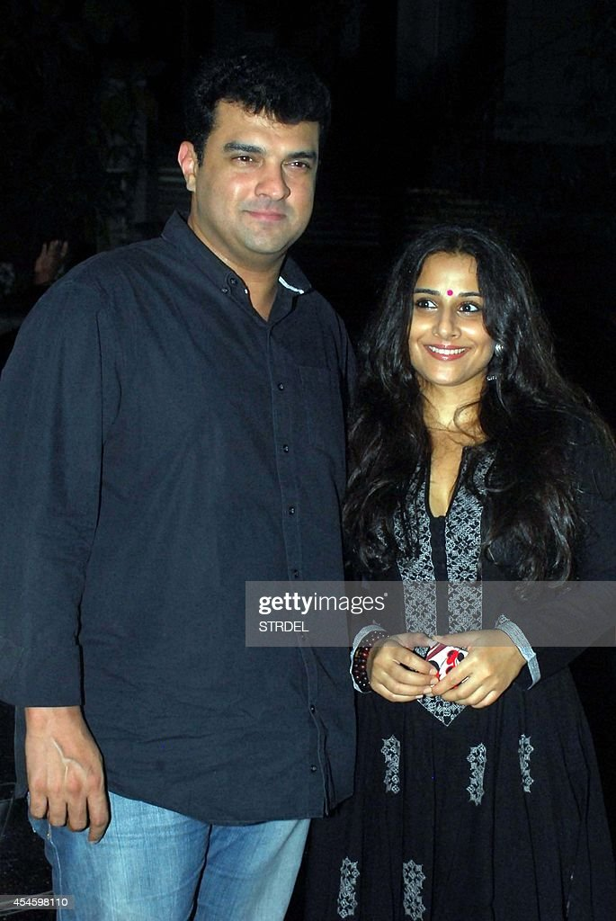 Indian Bollywood actress Vidya Balan (R) with her husband and producer <a gi-track='captionPersonalityLinkClicked' href=/galleries/search?phrase=Siddharth+Roy+Kapur&family=editorial&specificpeople=6236847 ng-click='$event.stopPropagation()'>Siddharth Roy Kapur</a> pose during a screening of the English/Hindi film 'Finding Fanny' in Mumbai on September 3, 2014.