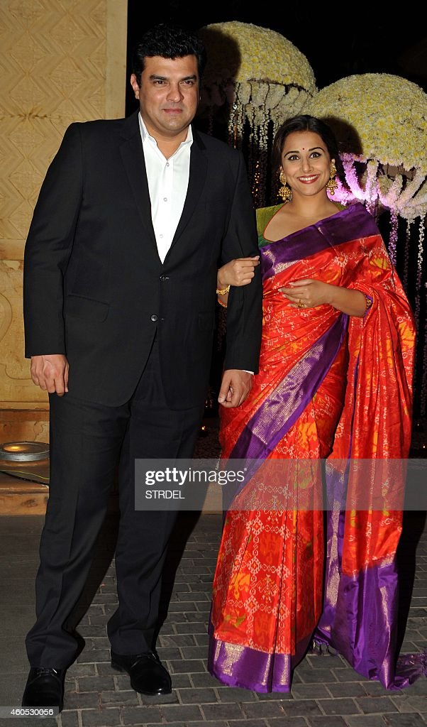 Indian Bollywood actress Vidya Balan with her husband producer <a gi-track='captionPersonalityLinkClicked' href=/galleries/search?phrase=Siddharth+Roy+Kapur&family=editorial&specificpeople=6236847 ng-click='$event.stopPropagation()'>Siddharth Roy Kapur</a> attend the wedding reception of Bollywood film director Punit Malhotra and Riddhi Malhotra, the sister of designer Manish Malhotra, in Mumbai on December 15, 2014. AFP PHOTO/STR