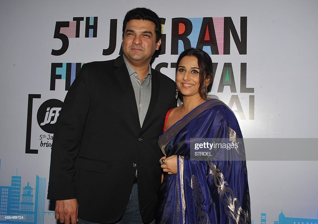 Indian Bollywood actress Vidya Balan with her husband Siddharth Roy Kapoor attend the opening ceremony of the 5th Jagran Film Festival in Mumbai on September 14, 2014.