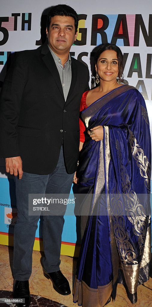 Indian Bollywood actress Vidya Balan with her husband Siddharth Roy Kapoor attend the opening ceremony of the 5th Jagran Film Festival in Mumbai on September 14, 2014. AFP PHOTO/STR