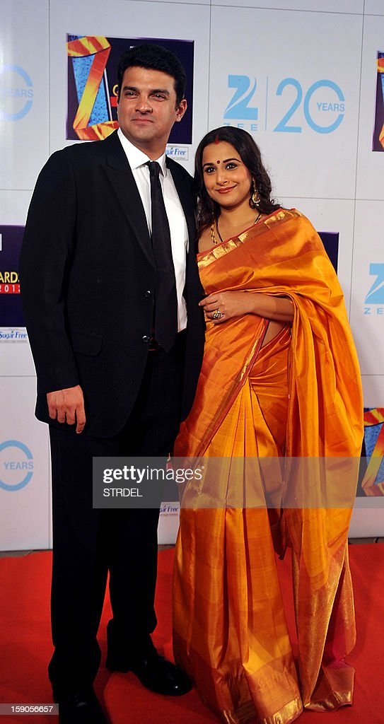 Indian Bollywood actress Vidya Balan with husband Siddharth Roy Kapur attend the Zee Cine Awards 2013 ceremony in Mumbai on January 6, 2013.