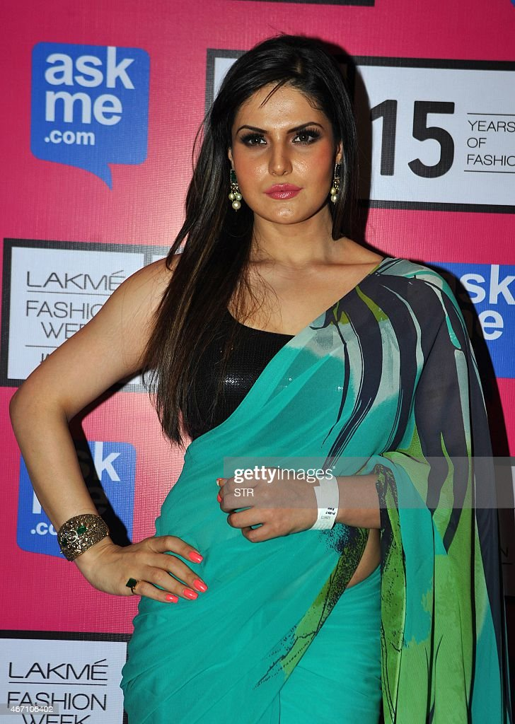 Indian Bollywood actress <a gi-track='captionPersonalityLinkClicked' href=/galleries/search?phrase=Zarine+Khan&family=editorial&specificpeople=6381777 ng-click='$event.stopPropagation()'>Zarine Khan</a> attends the third day of the Lakme Fashion Week (LFW) summer/resort 2015 in Mumbai on March 20, 2015.