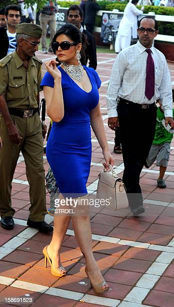Indian Bollywood actress Zarine Khan poses as she attends 'The Gitanjali Derby' at a racecourse in Mumbai on December 23 2012 AFP PHOTO/STR