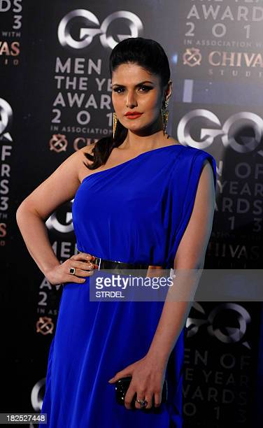 Indian Bollywood actress Zarine Khan poses as she attends the GQ India fifth anniversary 'Men of the Year' Awards ceremony in Mumbai late September...