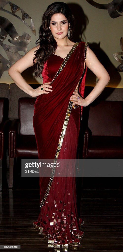 Indian Bollywood actress Zarine Khan poses for a photo during a preview of the latest India Wedding Collection being launched by Gitanjali Groups brand in Mumbai on September 17, 2013.