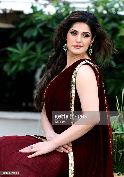 Indian Bollywood actress Zarine Khan poses for a photo during a preview of the latest India Wedding Collection being launched by Gitanjali Groups...