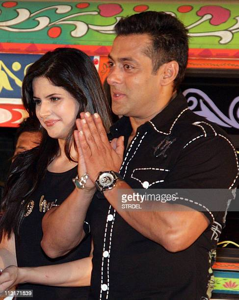 "Indian Bollywood actress Zarine Khan poses with actor Salman Khan during a music launch ceremony for the forthcoming Hindi comedy film ""Ready""..."