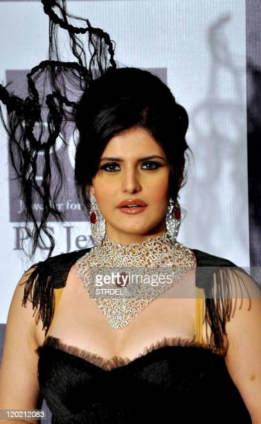 Indian Bollywood actress Zarine Khan walks the ramp for Johara Jewels during the 2nd edition of the Indian International Jewellery Week organised by...