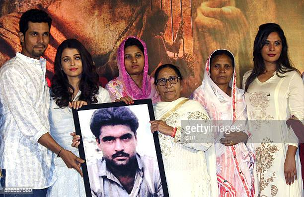Indian Bollywood actresses Aishwarya Rai Bachchanand Richa Chadda pose with actor Randeep Hoodaduring the promotion of the Hindi film Sarabjit based...