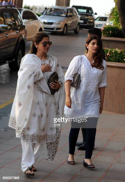 Indian Bollywood actresses Dimpal Kapadia and Twinkle Khanna arrive to attend a prayer meeting for the late Krishnaraj Rai the father of actress...