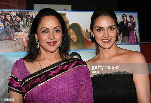 "Indian Bollywood actresses Esha Deol and Hema Malini pose during a ceremony for the forthcoming Hindi film ""Tell Me O Khuda"" in Mumbai late August 11..."