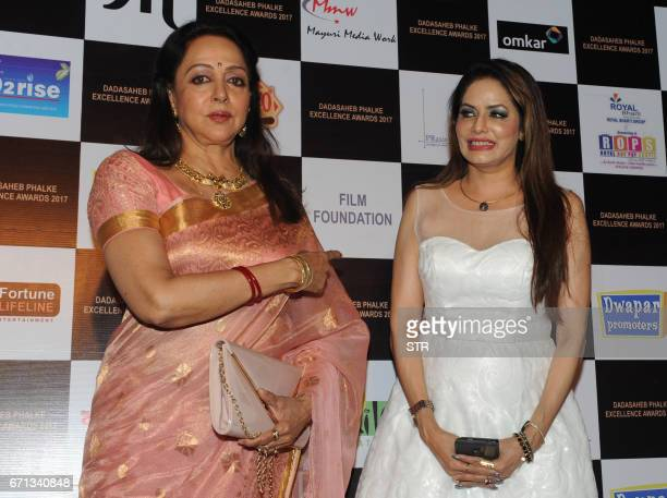 Indian Bollywood actresses Hema Malini and Poonam Jhawer pose as they attend the Dadasaheb Phalke Excellence Awards Ceremony 2017 in Mumbai on April...