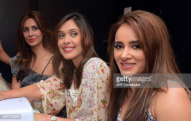 Indian Bollywood actresses Hrishita Bhatt and Shweta Khanduri pose for a photograph during the launch of 'I AM DESIGN' fashion store in Mumbai on...