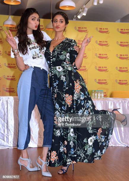 Indian Bollywood actresses Ileana DCruz and Athiya Shetty pose for a photograph during the promotional event for the forthcoming Hindi film Mubarakan...