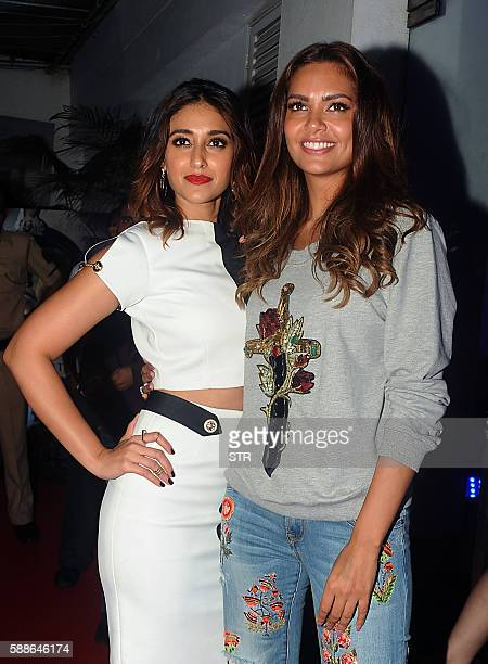 Indian Bollywood actresses Ileana D'Cruz and Esha Gupta pose as they attend the screening of Hindi film Rustom in Mumbai late August 11 2016 / AFP /...