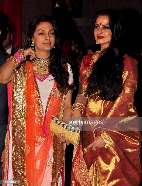 Indian Bollywood actresses Juhi Chawla and Rekha attend the wedding reception of actors Ritesh Deshmukh and Genelia D'Souza in Mumbai on February 4...