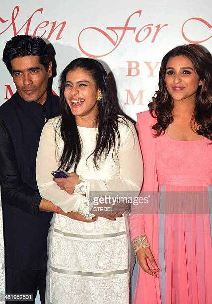Indian Bollywood actresses Kajol Devgn Parineeti Chopra and designer Manish Malhotra pose for a photograph during a charity fashion show in Mumbai on...
